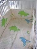 Baby-Nest dino, Baumwolle, grün-türkis auf natur